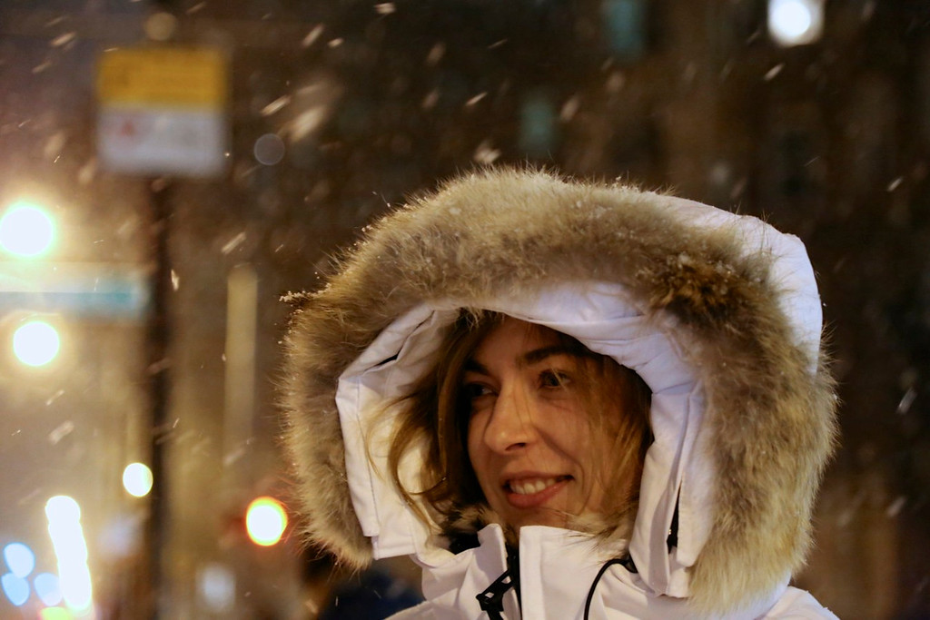 January 21, 2014- Stefania Semenova enjoys the snowfall from winter storm Janus while waiting for a cab on Commonwealth Avenue in Boston at 7:30pm on January 21, 2014. Photo by Taylor Hartz.