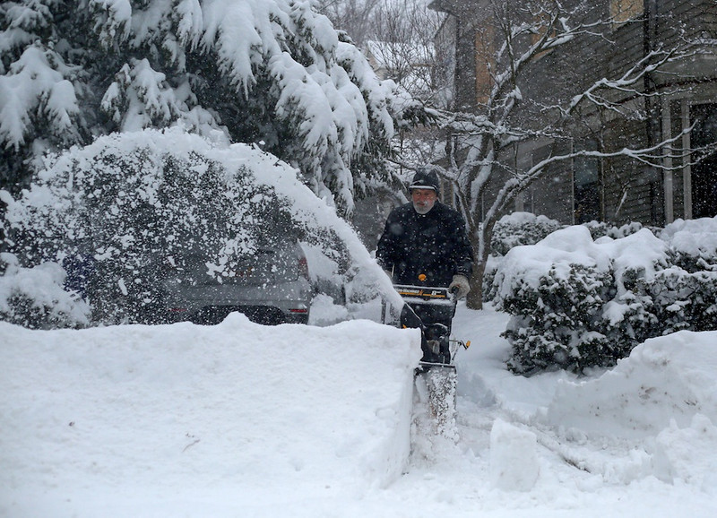 February 5, 2014 - A man uses a snow plow to clear his driveway in Brookline, Mass. Photo: Grace Donnelly/BU News Service.