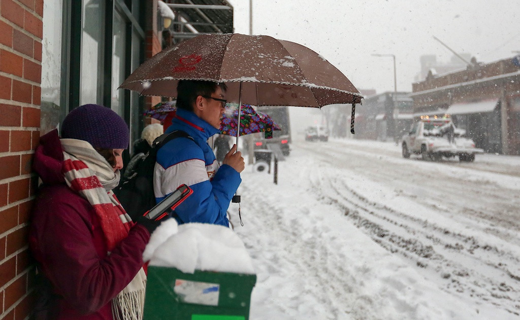 February 5, 2014 - Allston residents wait for the MBTA 66 bus as a snow storm hits Boston, Mass. on Wednesday Photo: Grace Donnelly/BU News Service.