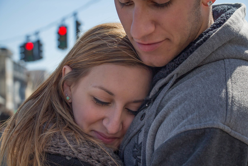 March 16, 2014 - Miranda, left, and Peter, right, hug near Andrew Station at the St. Patrick's Day parade in South Boston. Photo: Carolyn Bick/BU News Service.