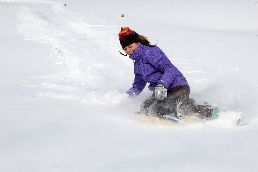 Camille Stockwell, 12, sleighs down a hill at the Boston Common in Boston, Mass., on Jan. 22, 2014.
