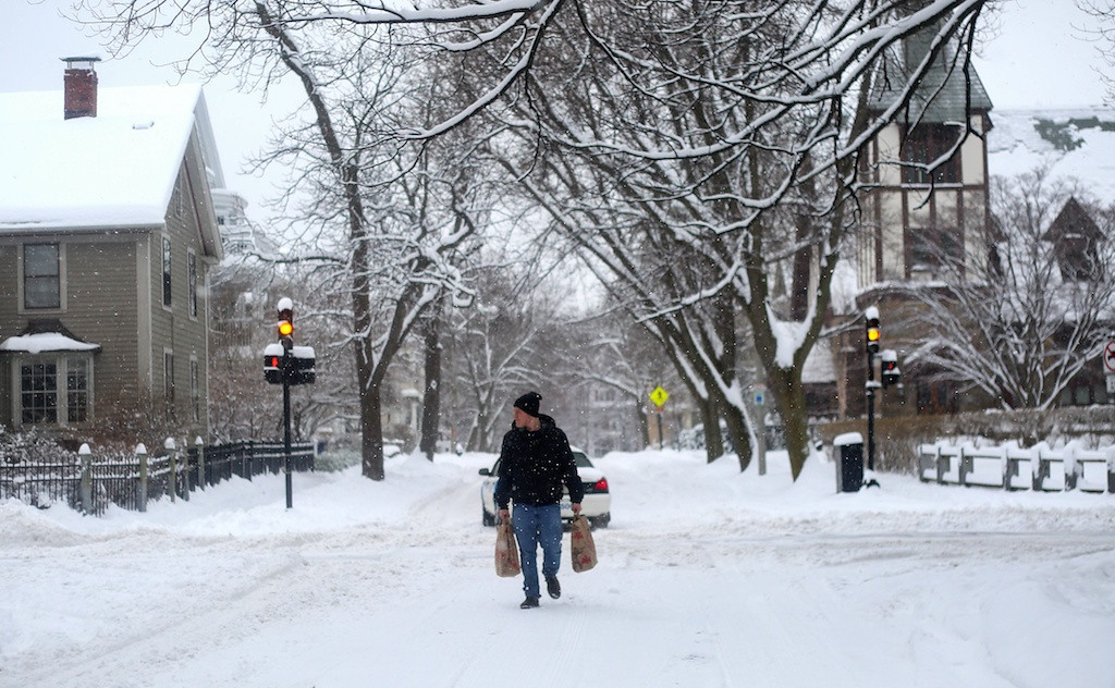 February 5, 2014 -A Brookline resident carries groceries through the street during a snow storm in Brookline, Mass. Photo: Grace Donnelly/BU News Service.