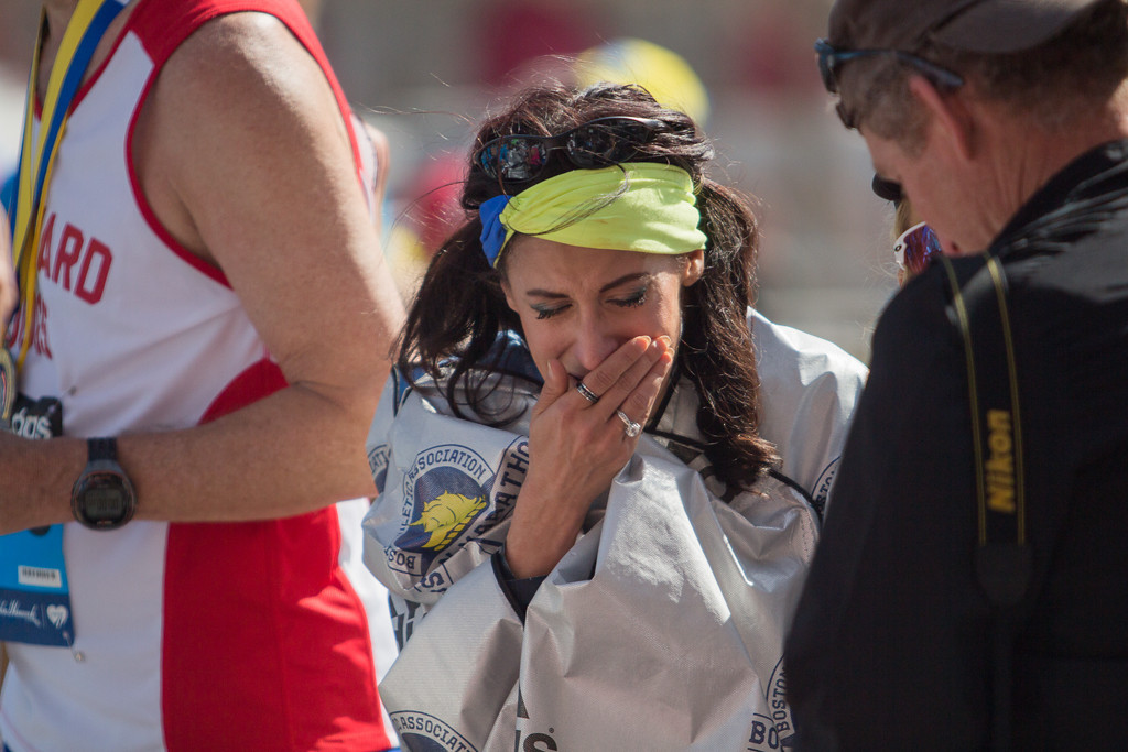April 21, 2014 - Lynn Crisci cries after finishing the 118th Boston Marathon. Crisci is a survivor of last year's Boston Marathon bombings. Prior to the bombing, Crisci lived with a connective tissue disorder, and a brain injury and chronic pain from an accident seven years ago. Crisci participated in the Marathon for the first time this year. Photograph by Carolyn Bick/BU News Service.