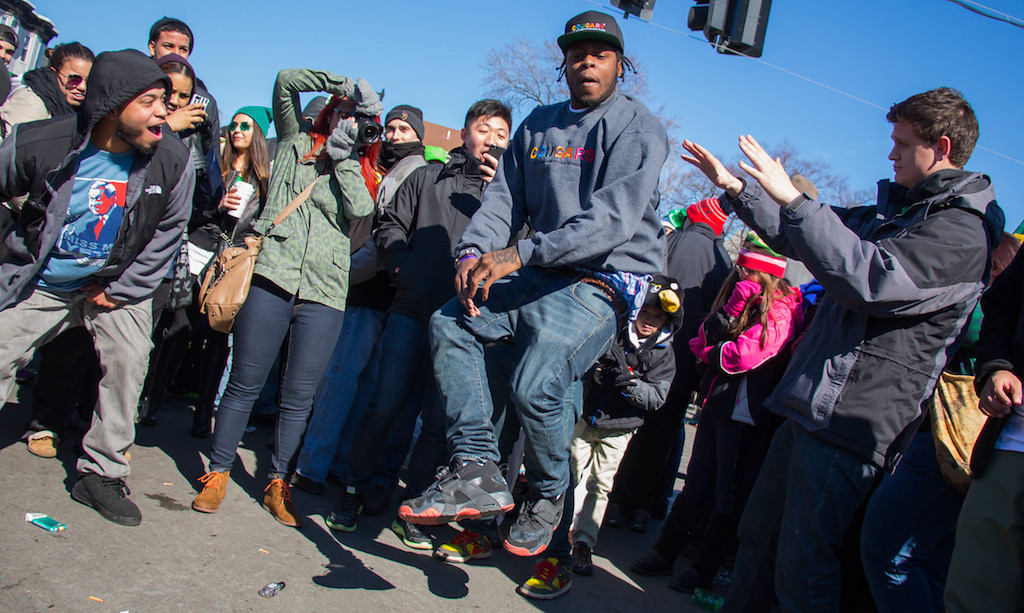 March 16, 2014 - Josh Aglon, center, entertains parade-goers with an impromptu dance performance near Andrew Station at the St. Patrick's Day parade in South Boston. Photo: Carolyn Bick/BU News Service.