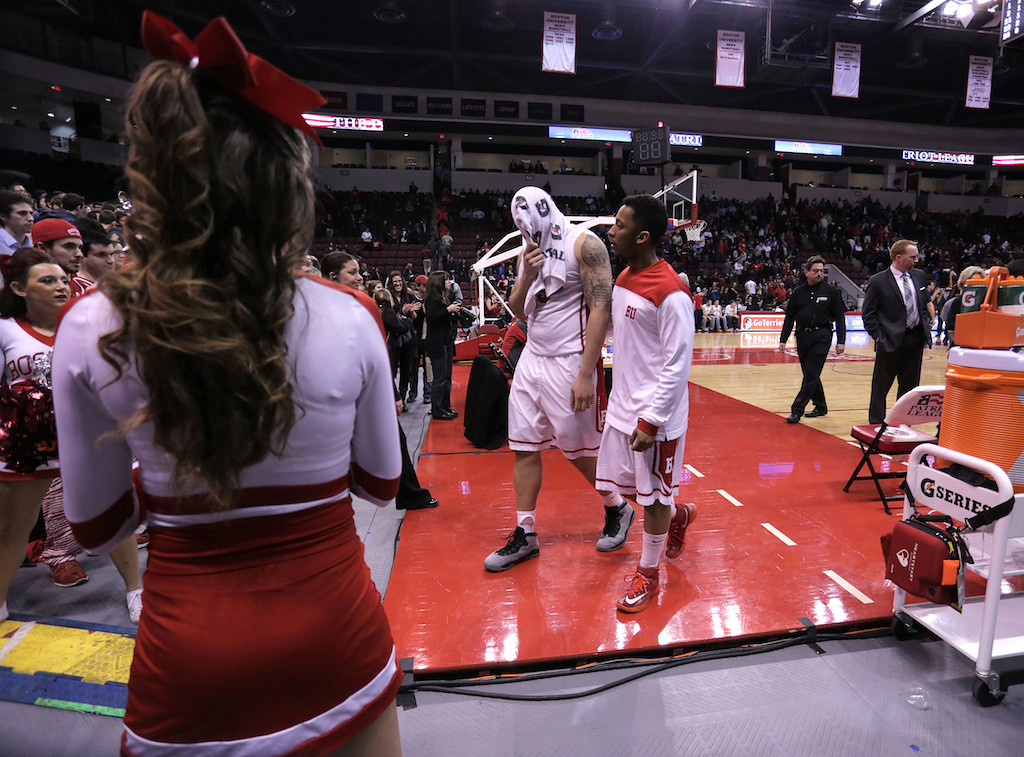 March 11, 2014 - Boston University Men's Basketball player, Dom Morris, walks with his towel over his head to the locker room at the end of the Patriot League's Championship game at Agganis Arena in Boston, Mass. American University men's basketball beat Boston Unviersity men's basketball 55-36. Photo: Grace Donnelly/BU News Service.