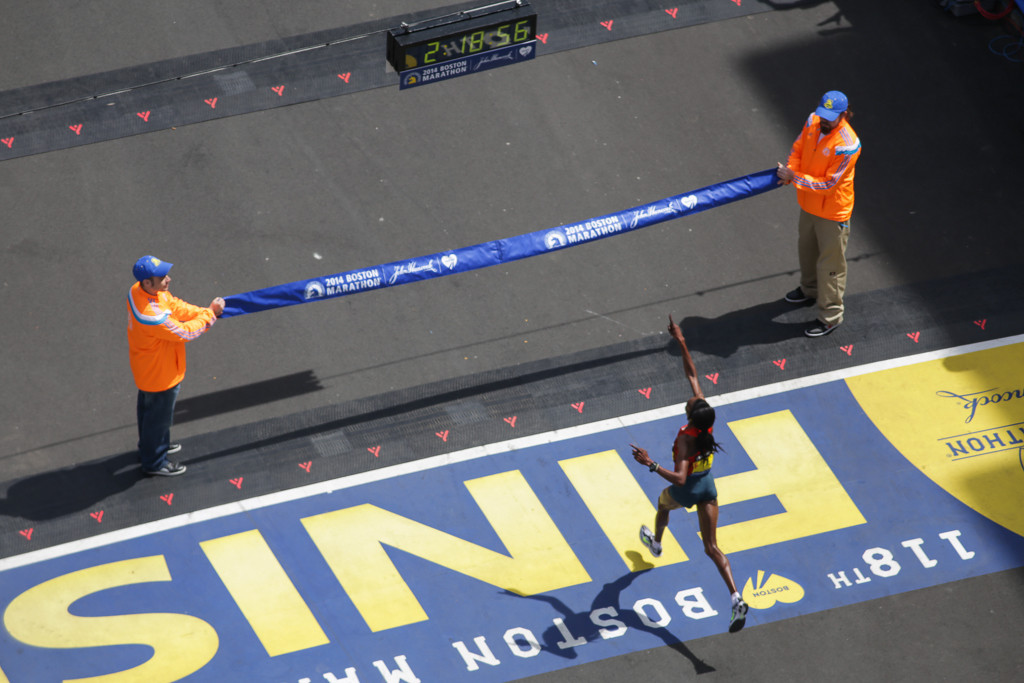 April 21, 2014 - Rita Jeptoo runs toward the finish line of the 118th Boston Marathon, becoming the first woman to finish. Photo by Taylor Hartz/BU News Service.