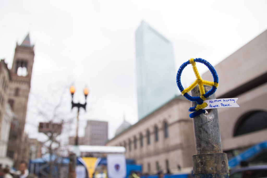 April 15, 2014 – An ornament with a message is attached to a fence near the finish line of the Boston Marathon on Boylston Street in Boston, Mass. Photo by Jun Tsuboike/BU News Service