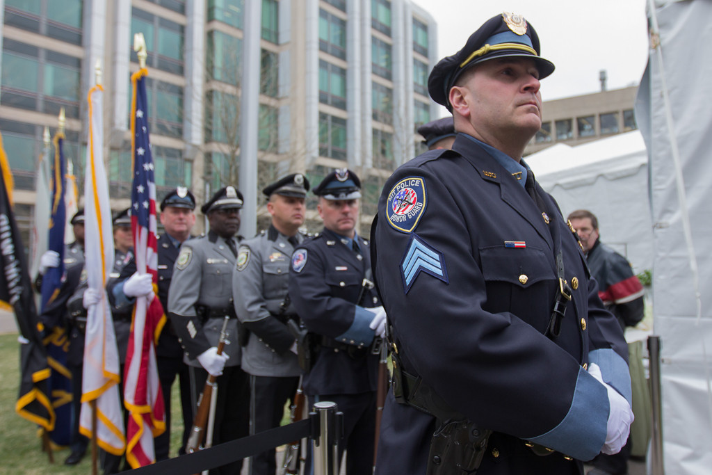 April 18, 2014 - Police officers wait to enter the memorial event for MIT Police Officer Sean Collier who was killed by the Boston Marathon bombing suspects in April 2013. Photo by Jun Tsuboike/BU News Service