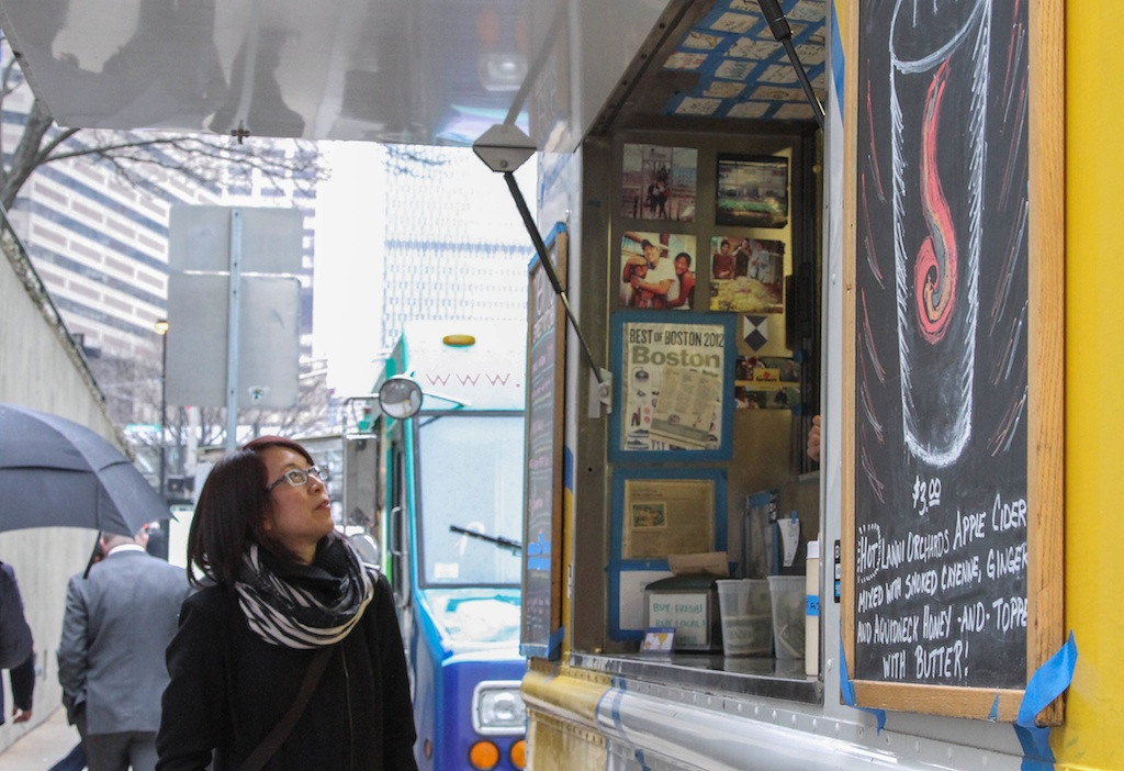 "March 12, 2014 - Susanna Tran waits for her lunch order outside of Mei Mei food truck. ""I'm waiting for the bread pudding to come back!"" says Tran of truck's seasonal treat. Photo: Andrea Betenia/BU News Service."