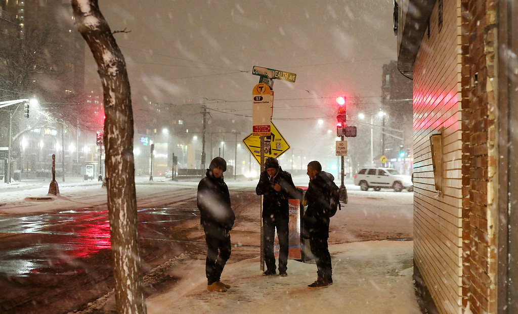 Bostonians wait for the 57 bus at Packards Corner in Allston, Mass. on Jan. 21, 2014 as the winter storm Janus hits Boston. Photo by Grace Donnelly.