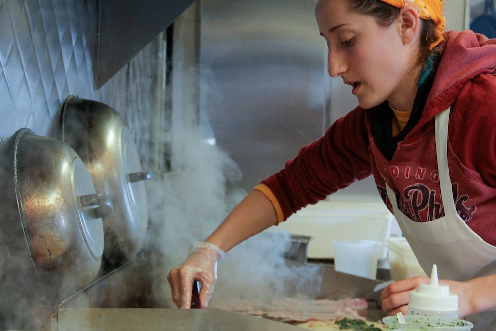 "February 7, 2014 - Gabrielle Balestrier, a Suffolk University student, works in the Mei Mei food truck 20 hours a week. ""I wanted to try working in a food truck. Turns out it is awesome!"" said Balestrier. Photo: Andrea Betenia/BU News Service."