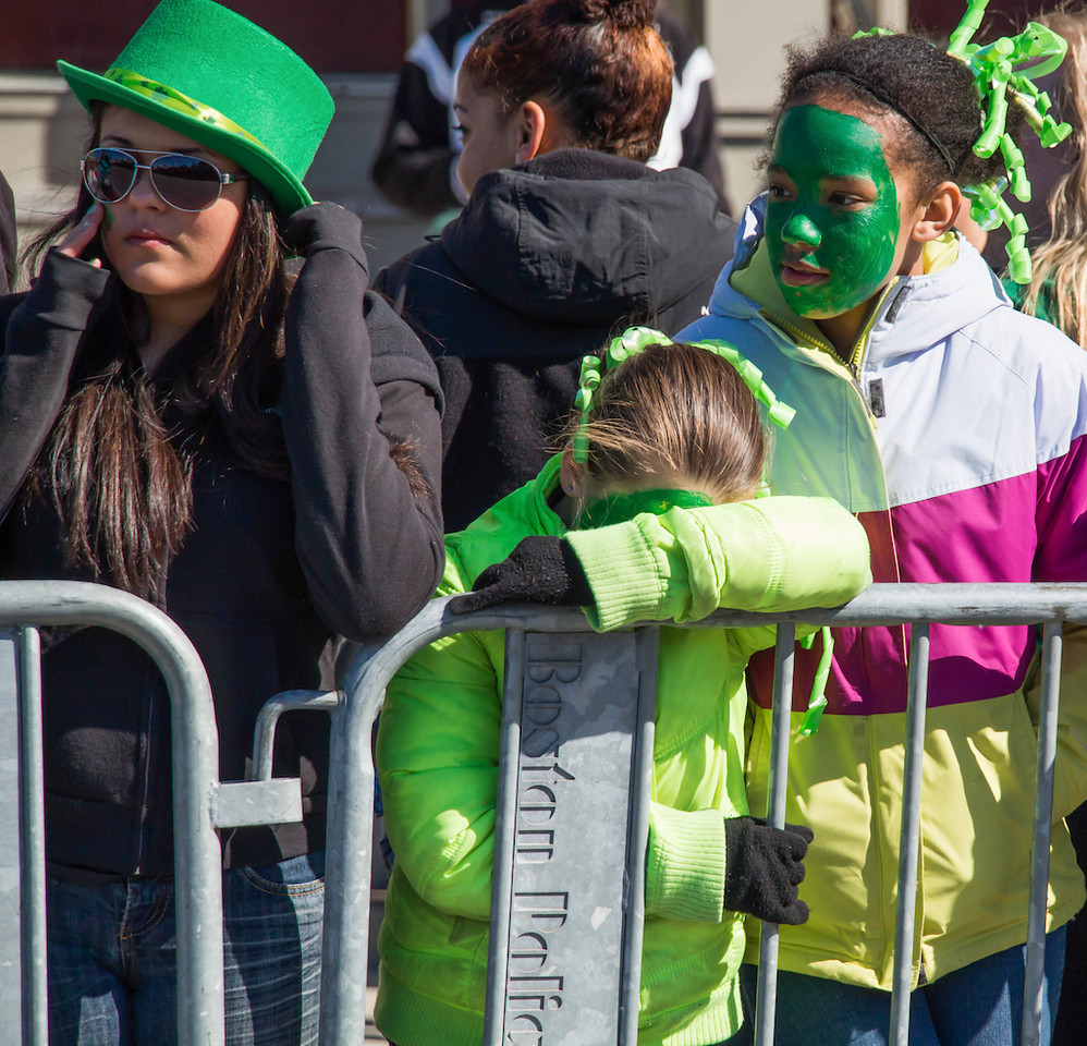 Boston, March 16, 2014 - Parade-goers wait along the parade route near Andrew Station at the St. Patrick's Day parade in South Boston. Photo: Carolyn Bick/BU News Service.