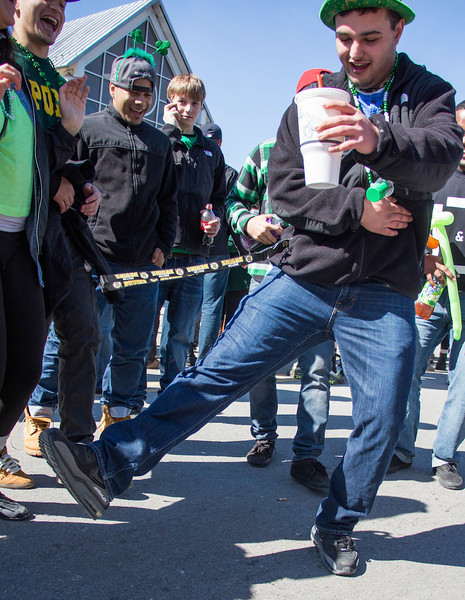 Boston, March 16, 2014 - Andrew Carter does a jig near Andrew Station at the St. Patrick's Day parade in South Boston. Photo: Carolyn Bick/BU News Service.