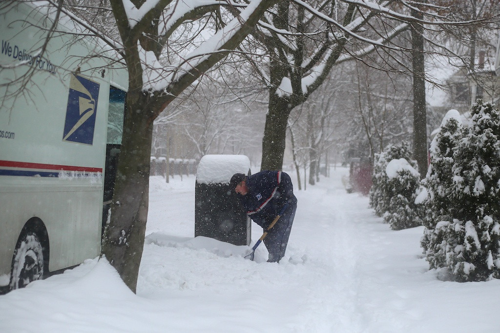 February 5, 2014 - A mailman shovels snow around a mailbox in Brookline, Mass. Photo: Grace Donnelly/BU News Service.