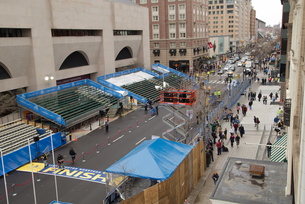 April 15, 2014 – A tribute event for those affected by last year's Boston Marathon bombings is set up at the finish line on Boylston Street in Boston, Mass. Photo by Jun Tsuboike/BU News Service