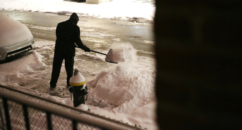A man shovels snow on Fordham Rd. in Allston, Mass. on Jan. 21, 2014 as the winter storm Janus hits Boston. Photo by Grace Donnelly.