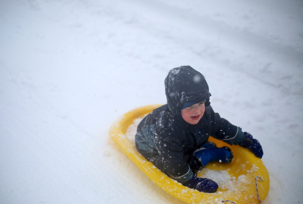 February 5, 2014 - A child is pulled by his parents on a sled on Babcock St. in Brookline, Mass. Photo: Grace Donnelly/BU News Service.