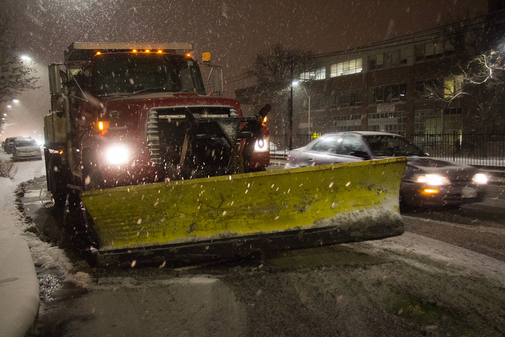 Boston, Jan. 21, 2014 -- An unmanned snow plow sits in front of Planned Parenthood on Commonwealth Avenue in Boston, MA, during the first few hours of Winter Storm Janus. Photograph by Carolyn Bick. ©BU News Service/Carolyn Bick 2014.