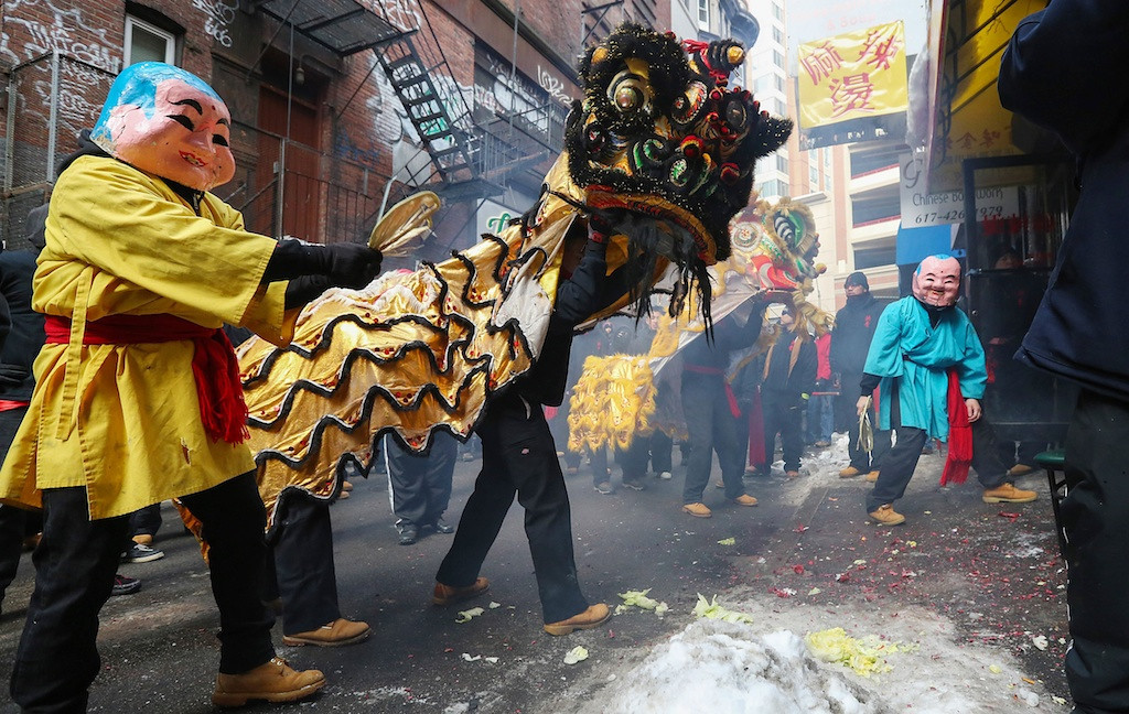 February 8, 2014 -Performers dance the lion dance to scare off the evil spirts, a Chinese tradition in the Chinese New Year Parade in Chinatown, Boston, Mass. Photo: Grace Donnelly/BU News Service.