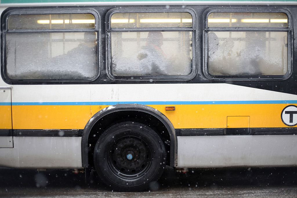 Commuters take the 57 bus down Commonwealth Ave. in Allston, Mass. on Jan. 22, 2014 as the winter storm Janus hits Boston. Photo by Grace Donnelly.
