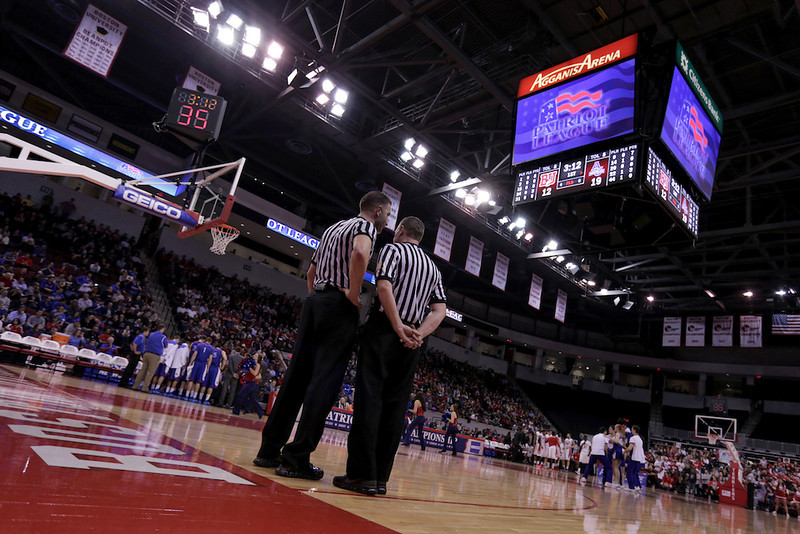 March 11, 2014 - Referees chat during a timeout in the first half of the Patriot League's Championship game at Agganis Arena in Boston, Mass. American University men's basketball beat Boston University men's basketball 55-36. Photo: Grace Donnelly/BU News Service.