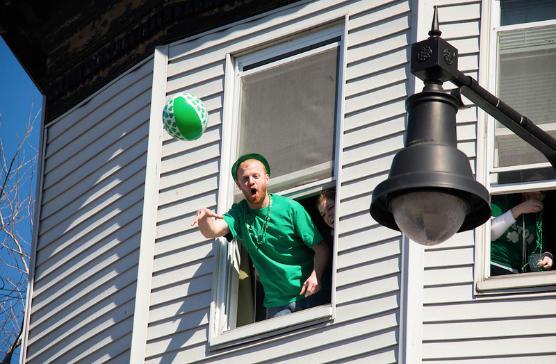March 16, 2014 - A man throws a beach ball into a crowd of parade-goers near Andrew Station at the St. Patrick's Day parade in South Boston. Photo: Carolyn Bick/BU News Service.