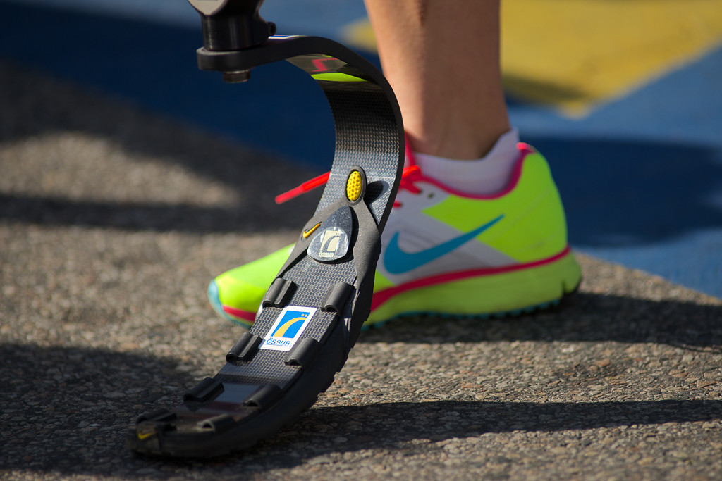 April 21, 2014 - A woman poses with her prosthetic leg at the starting line of the Boston Marathon in Hopkinton, Mass. She ran in the marathon with the wave of mobility impaired runners. Photo by Andrew Prince/BU News Service.