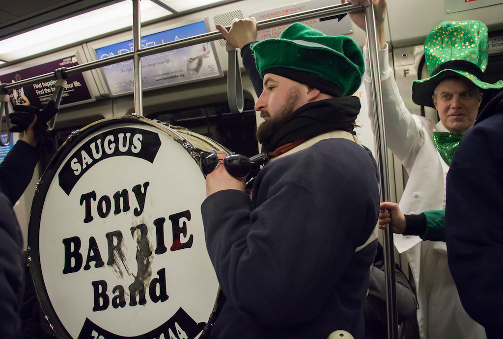 March 16, 2014 - Performer Harrison Swyter rides the T after finishing the St. Patrick's Day parade route at Andrew Station in South Boston. Photo: Carolyn Bick/BU News Service.
