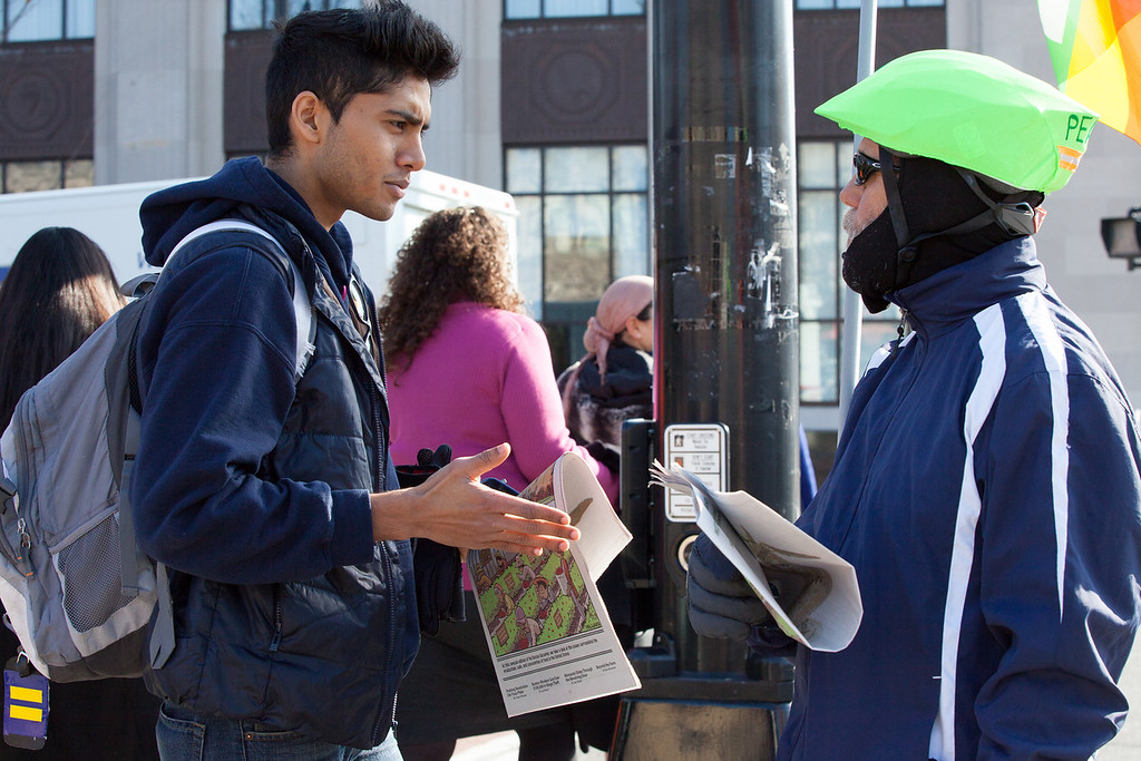 "November 17 2012 - Saiful Saleem (left), a Boston University senior, stops to talk with Irv Kurki (right) during a Peace Vigil in Coolidge Corner in Brookline, MA on Saturday. ""Some people are more wiling to talk than others,"" said Kurki, ""and we get a lot more support now than we did back when the war was just starting."" Photo by Alexa Gonzalez Wagner."