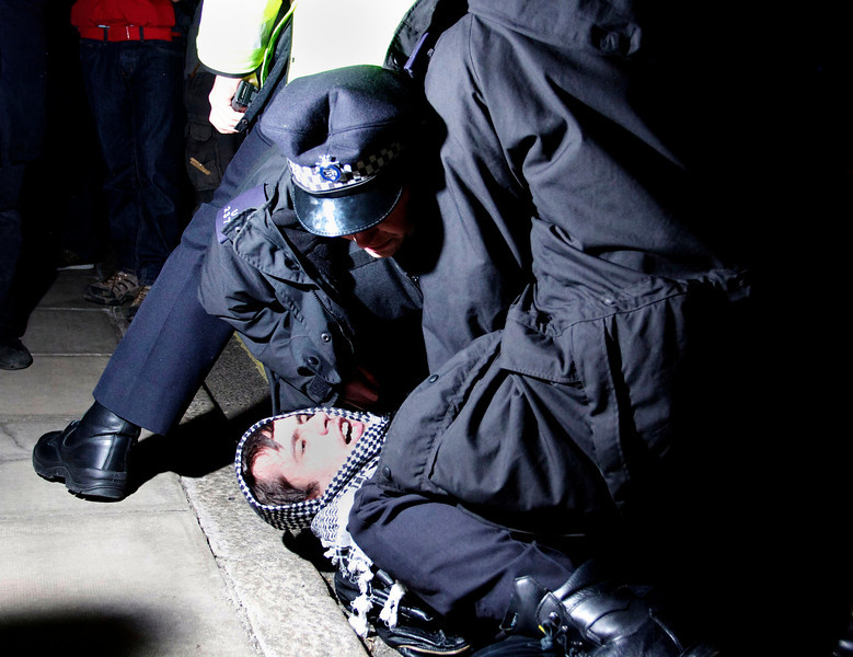 An Occupy London protester gets arrested for shoving a police officer on November 5 in London, England after a dancing demonstration in Picadilly Circus went out of control.