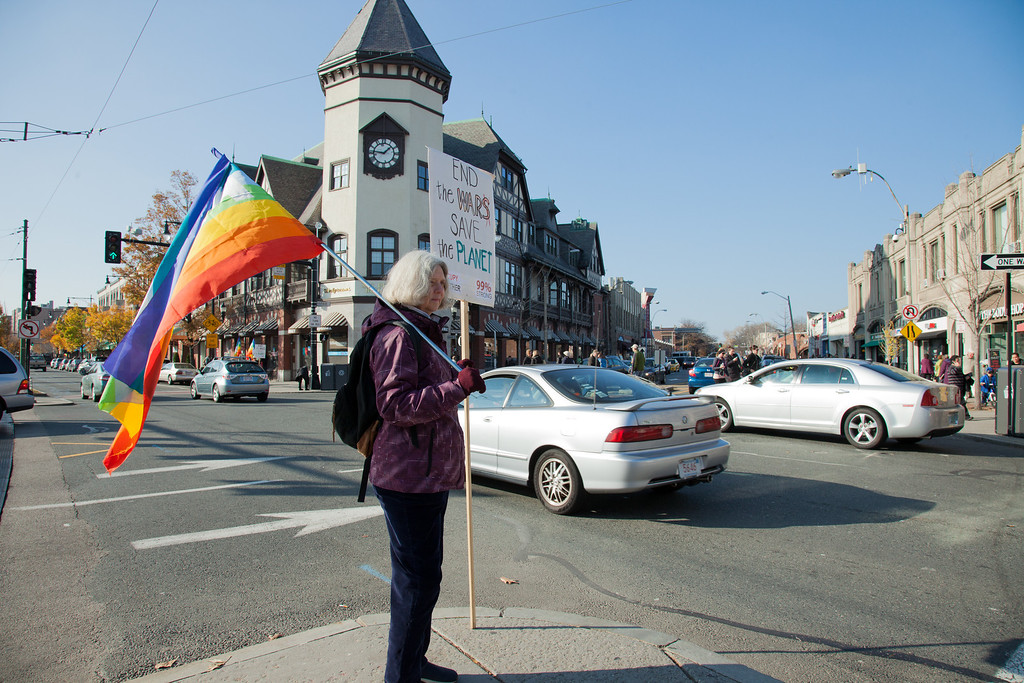 November 17 2012 - Kea van der Zeil, a retired doctor from Brookline MA, participates in a Peace Vigil in the busy Coolidge Corner intersection in Brookline on Saturday. The group has been actively protesting in the area on as many Saturdays as possible since 2003. Photo by Alexa Gonzalez Wagner.
