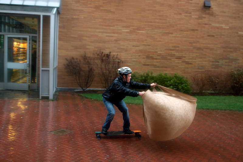 Boston Univsity junior Ted Beck uses a skateboard and a bed sheet to try and catch the wind brought by Hurricane Sandy in BU's West Campus on Monday October 28, 2012. (Photo by Michael Cummo)