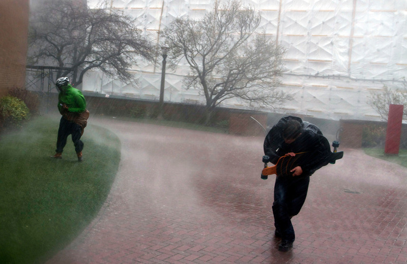 Boston Univsity junior Ted Beck, right, and freshman Gopal Srinivas brave Hurricane Sandy as it hits BU's West Campus on October 28, 2012. (Photo by Michael Cummo)