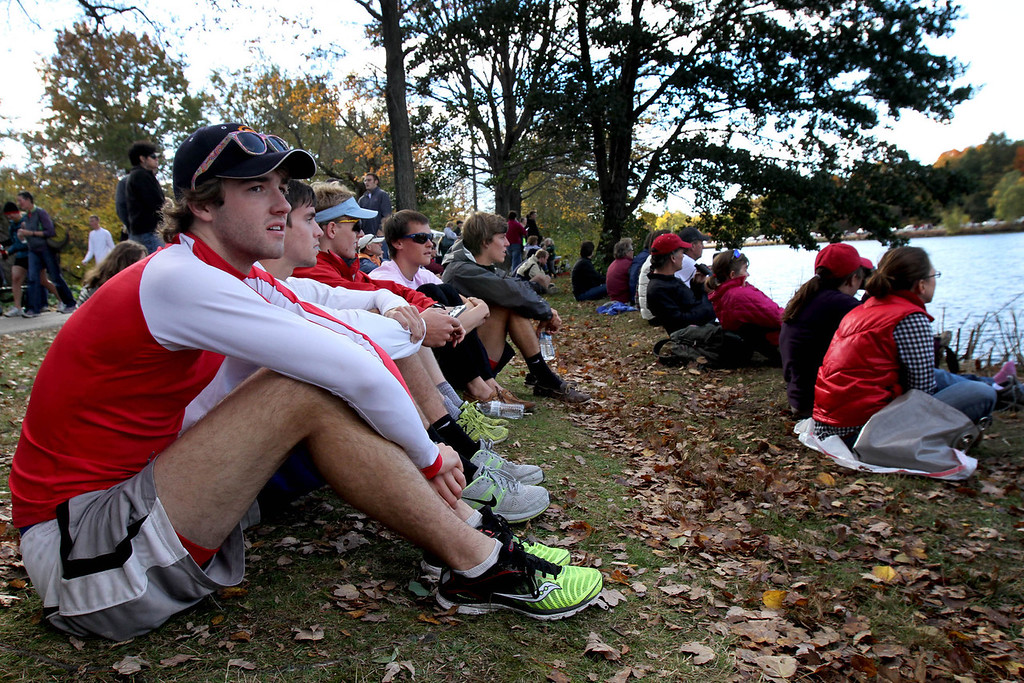 Oct. 21, 2012 – Junior Sam Shaw (left) and other members of the University of Pennsylvania men's lightweight rowing team watch the 2012 Head Of The Charles Regatta in Boston, Massachusetts before their race. The team arrived at the course five hours before their race began. Photo by Billie Weiss.