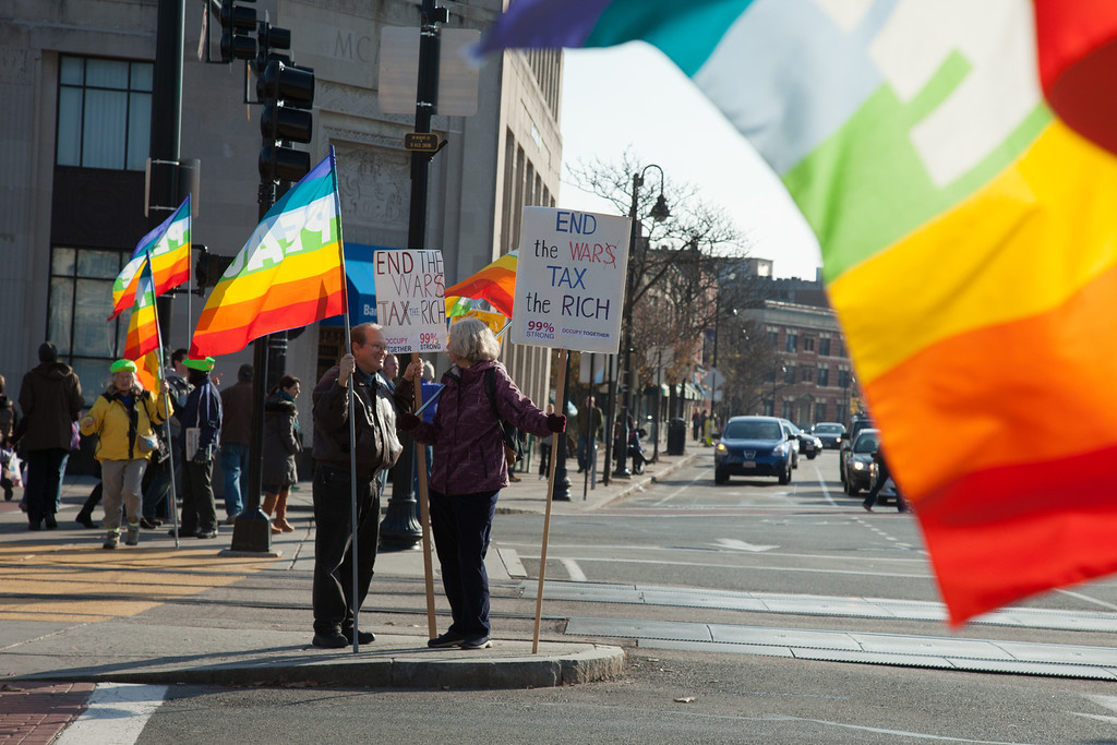 November 17 2012 - Protesters participate in a Peace Vigil held by Brookline Peace Works in the Coolidge Corner intersection in Brookline, MA on Saturday. The group has been actively protesting in Coolidge Corner on as many Saturdays as possible since 2003. Photo by Alexa Gonzalez Wagner.