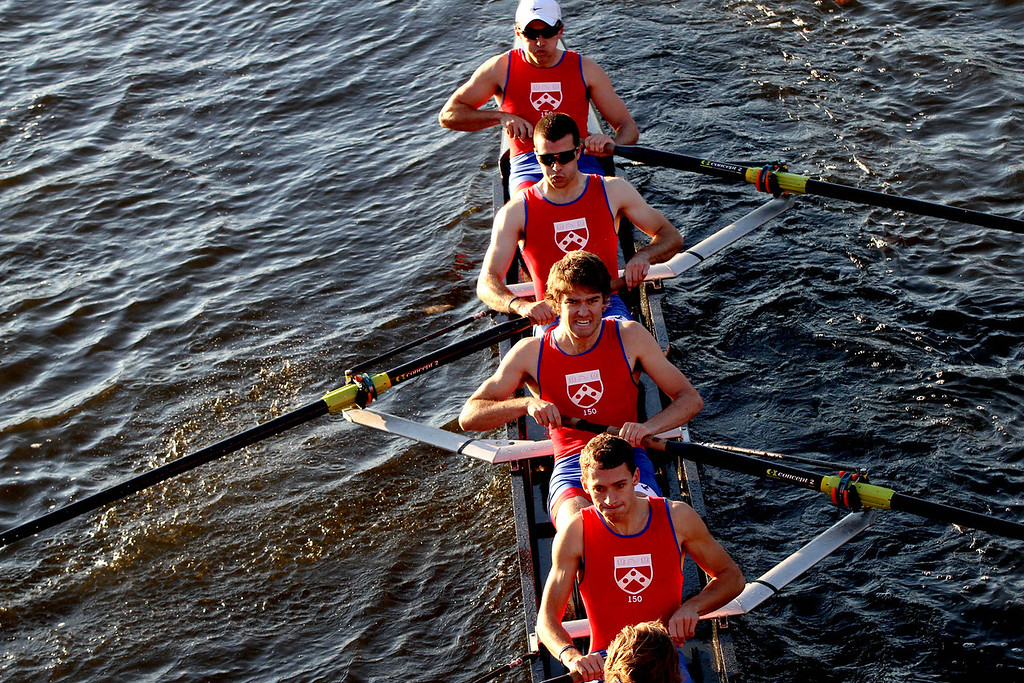 Oct. 21, 2012 – (Top to Bottom) Senior Mark Gannon, Juniors T.J. Smith and Sam Shaw, and Senior James Shovelin of the University of Pennsylvania men's lightweight rowing team finish a stroke as they compete in the 2012 Head Of The Charles Regatta in Boston, Massachusetts. The team finished the 3.2 mile race in 15:31.98, placing fifteenth in their event. Photo by Billie Weiss.