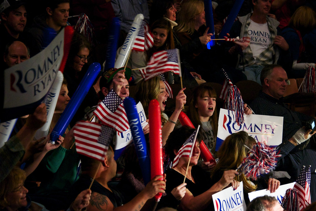 Nov. 5, 2012 – Romney supporters wait for Mitt Romney's arrival at a campaign rally in Manchester, N.H. Monday night. Mitt and Anne Romney teamed up with Kid Rock to rally voters in New Hampshire on the eve of Election Day. Photo by Cat Ring.