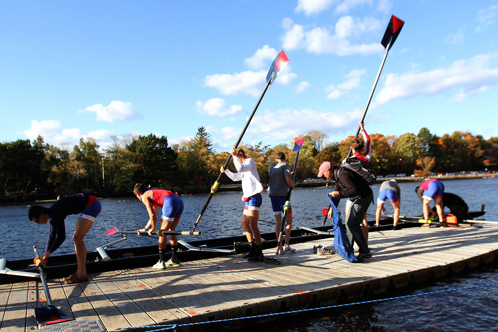 Oct. 21, 2012 – Members of the University of Pennsylvania men's lightweight rowing team place their racing shell into the Charles River before racing in the 2012 Head Of The Charles Regatta in Boston, Massachusetts. The team was seeded tenth out of 18 schools in the Men's Lightweight Eights event. Photo by Billie Weiss.