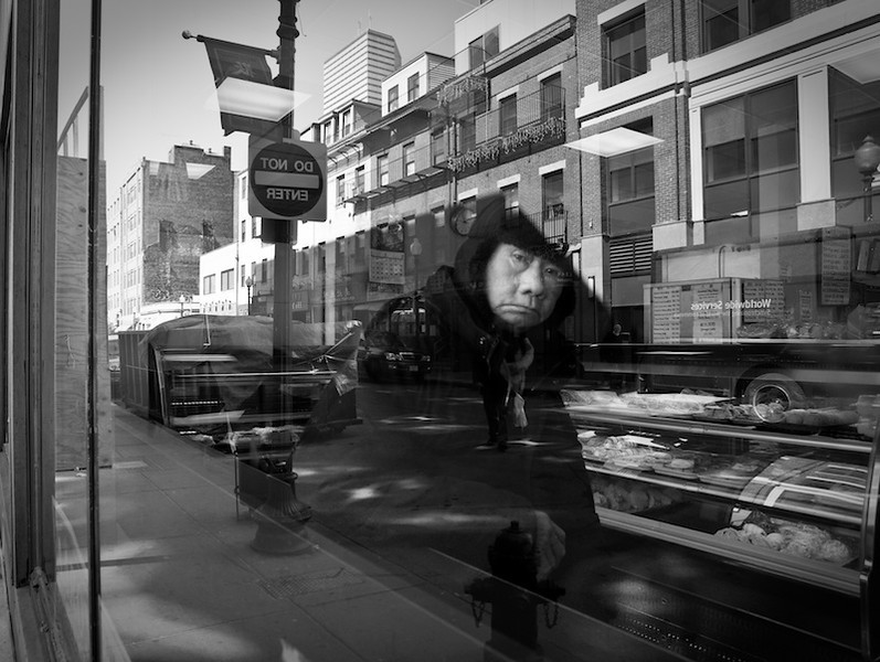 A man pauses in reflection in Boston's Chinatown in the spring of 2009.<br /> <br /> photo by: graduate student, Ryan McCune