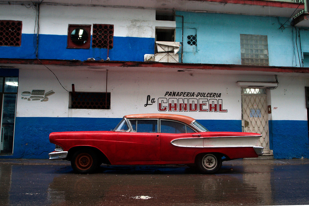 A car sits on the rainy pavement on March 25 in Cuba.