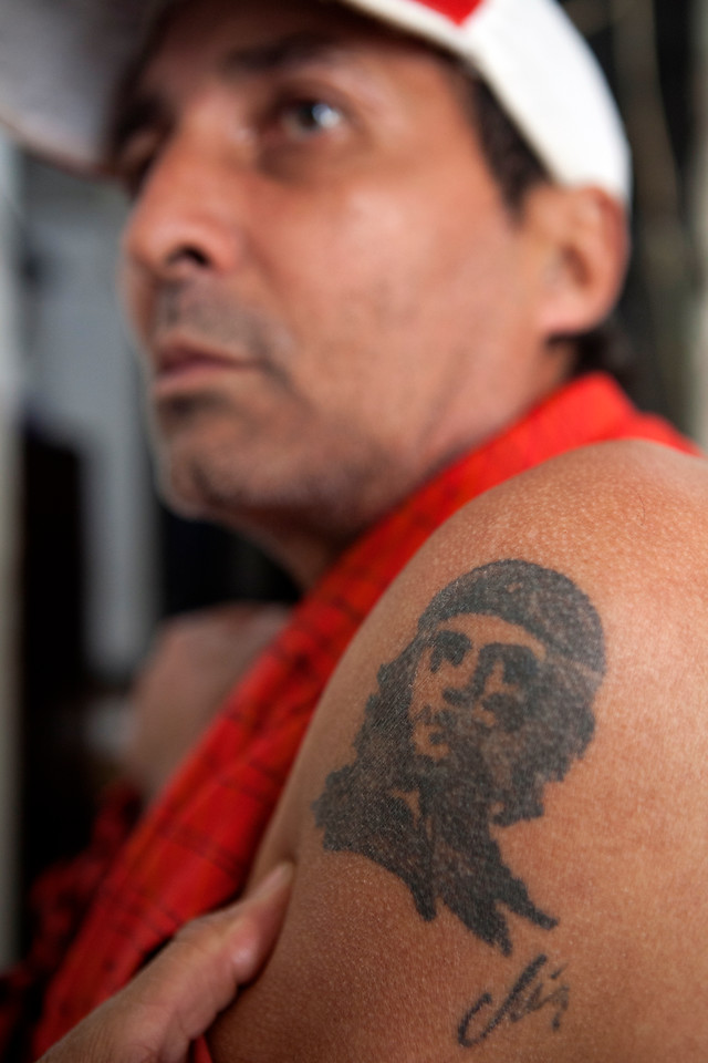 "March 26, 2013- Jose Guillermo Deltoro shows his Che Guevara arm tattoo in his home in Old Havana, Cuba. ""Che was a noble doctor, he was a very honest person, not like Fidel,"" Deltoro said. Photo by Melanie Rieders."