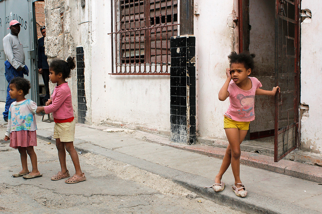 A young girl pauses in the street outside of her house of Old Havana, Cuba on March 28, 2013. Photo by Stacey Rupolo/BU News Service.
