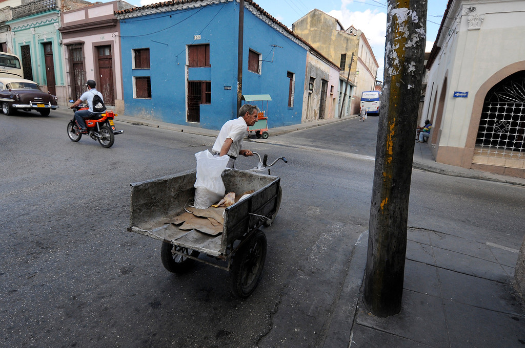 A man pulls his cart in the city of Cardenas, Cuba on March 30, 2013. (Photo by: Michael Cummo)