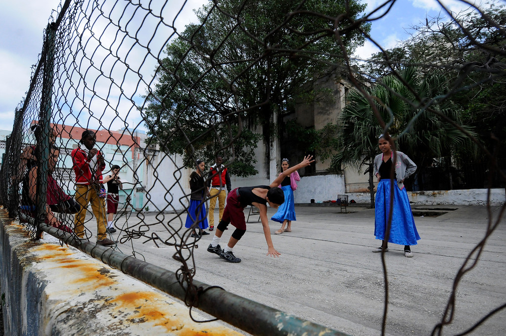 School children take a break from dancing practice in Havana, Cuba on March 27, 2013. (Photo by: Michael Cummo)