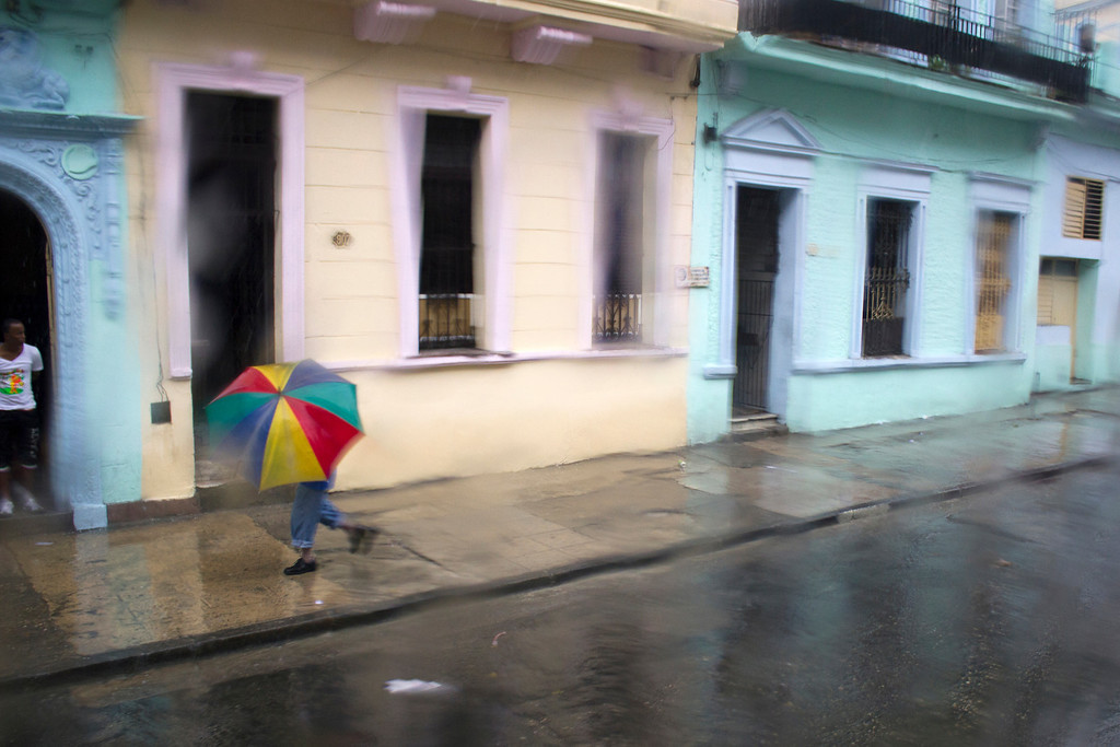 A man shelters himself from the rain in Havana, Cuba on March 25, 2013. Photo by Stacey Rupolo / BU News Service.