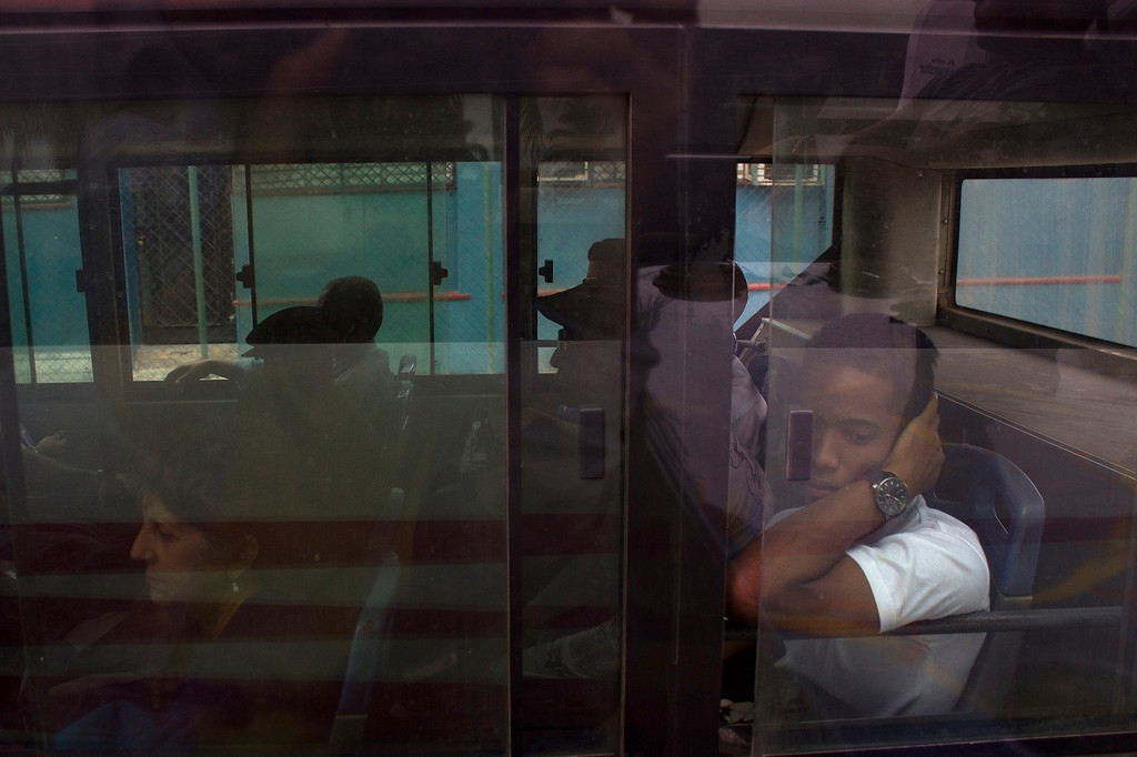 A man stares out the window of a bus heading to downtown Havana, Cuba on March 26, 2013. Photo by Stacey Rupolo / BU News Service.