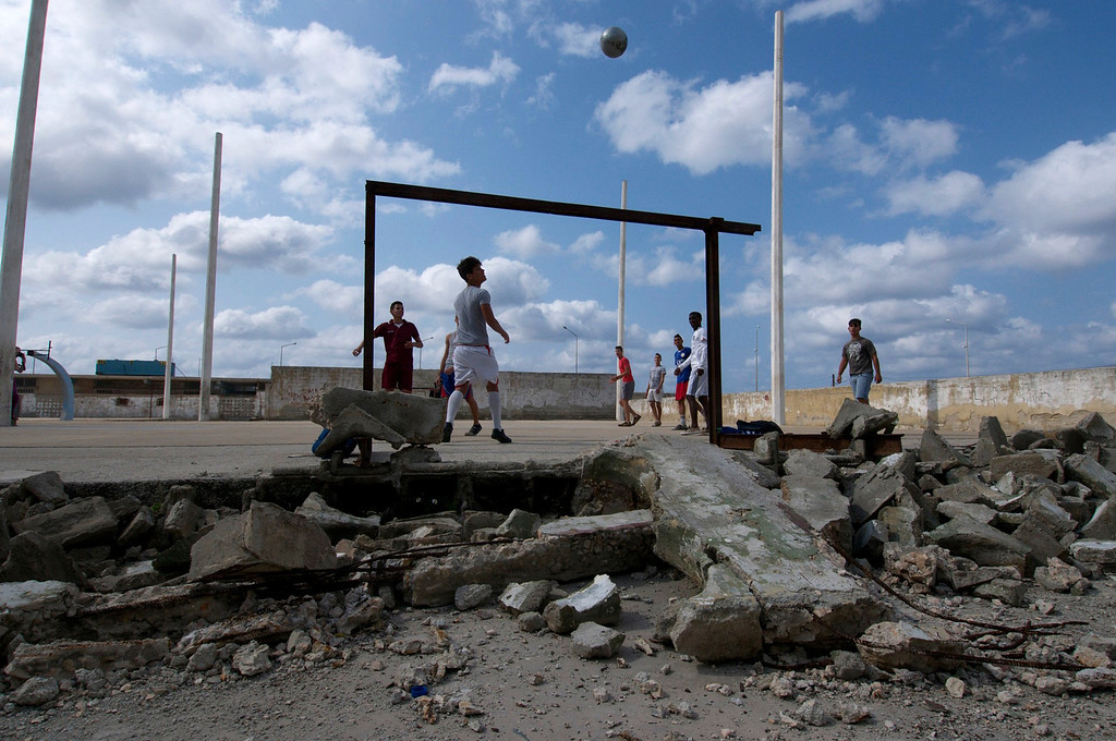 Boys play a pickup game of soccer at the Parque Jose Marti Stadium in Havana, Cuba on March 26, 2013. Every day they would meet up after school to play a game of baseball, but it was too windy so they played soccer on a patch of pavement instead. (Photo by: Michael Cummo)