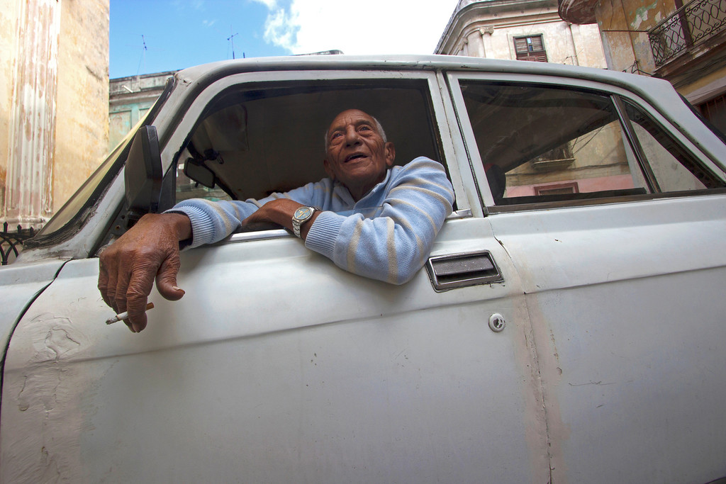 March 27, 2013- A local taxi driver sits in his car in Old Havana, Cuba on Wednesday. Photo by Melanie Rieders.