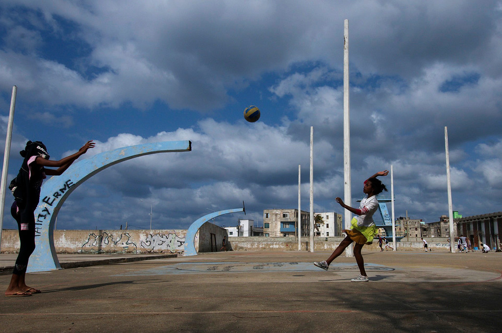 Two girls play volleyball at the Parque Jose Marti Stadium in Havana, Cuba on March 26, 2013. Every day they would meet up after school to play a games. (Photo by: Michael Cummo)