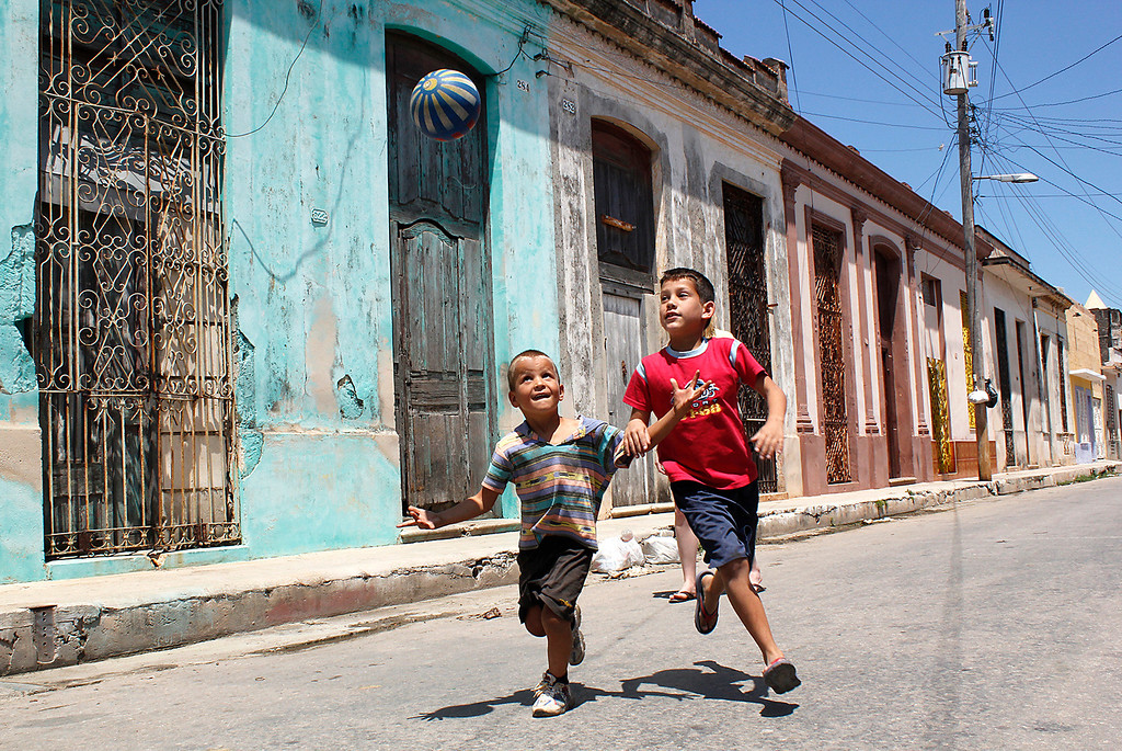 Two young boys play with a ball in the street in Cardenas, Cuba on March 30, 2013. Photo by Stacey Rupolo / BU News Service.